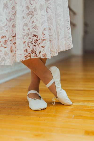 Close up of Monas feet in ballet shoes