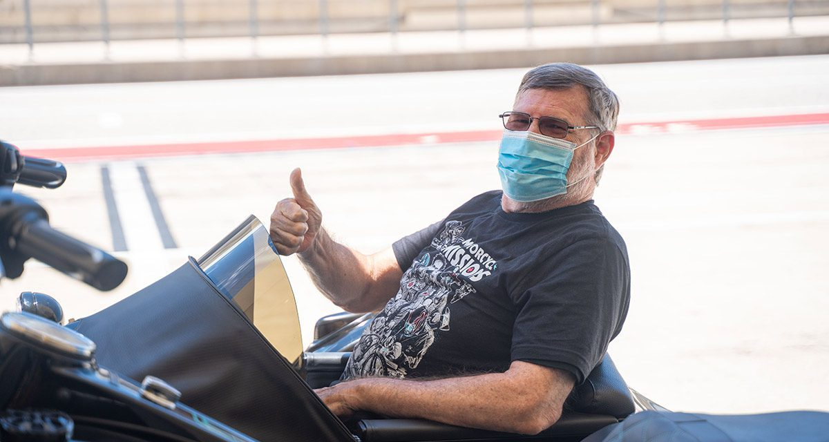 David gives thumbs up from motorcycle sidecar