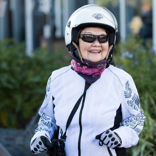 Helen poses in motorcycle helmet outfit